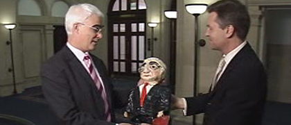 Alistair Darling receives Anita Russell's Papier Mache sculpture