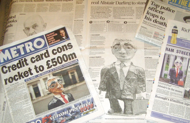 newspaper articles about the papier mache creation of a politician