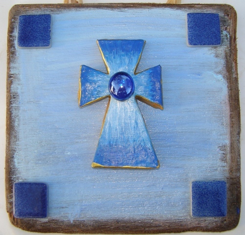 Papier mache cross gift by Anita Russell set on driftwood