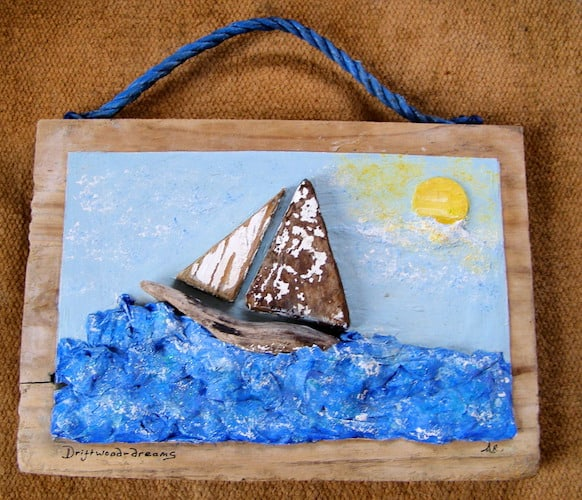 driftwood boat on papier mache sea