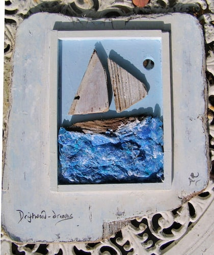 papier mache sea with driftwood boat and frame
