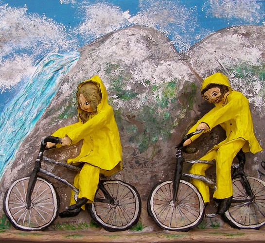 Hawaii cyclists in a storm. Papier mache sculpture by Anita Russell