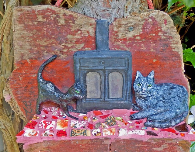 'Cats by the Fire' a papier mache sculpture of two favourite pet cats