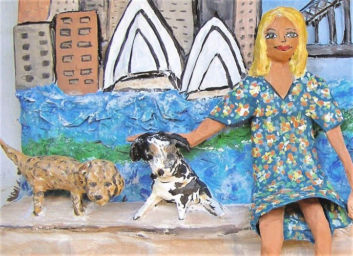 Feature of two adored puppies with their owner made of papier mache