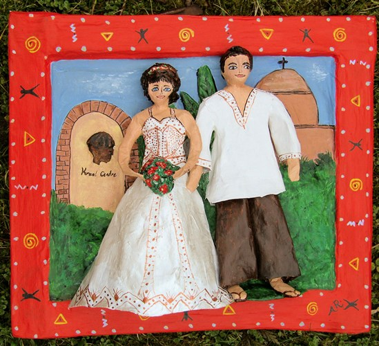 Papier mache sculpture of a wedding in Africa. Artist Anita Russell